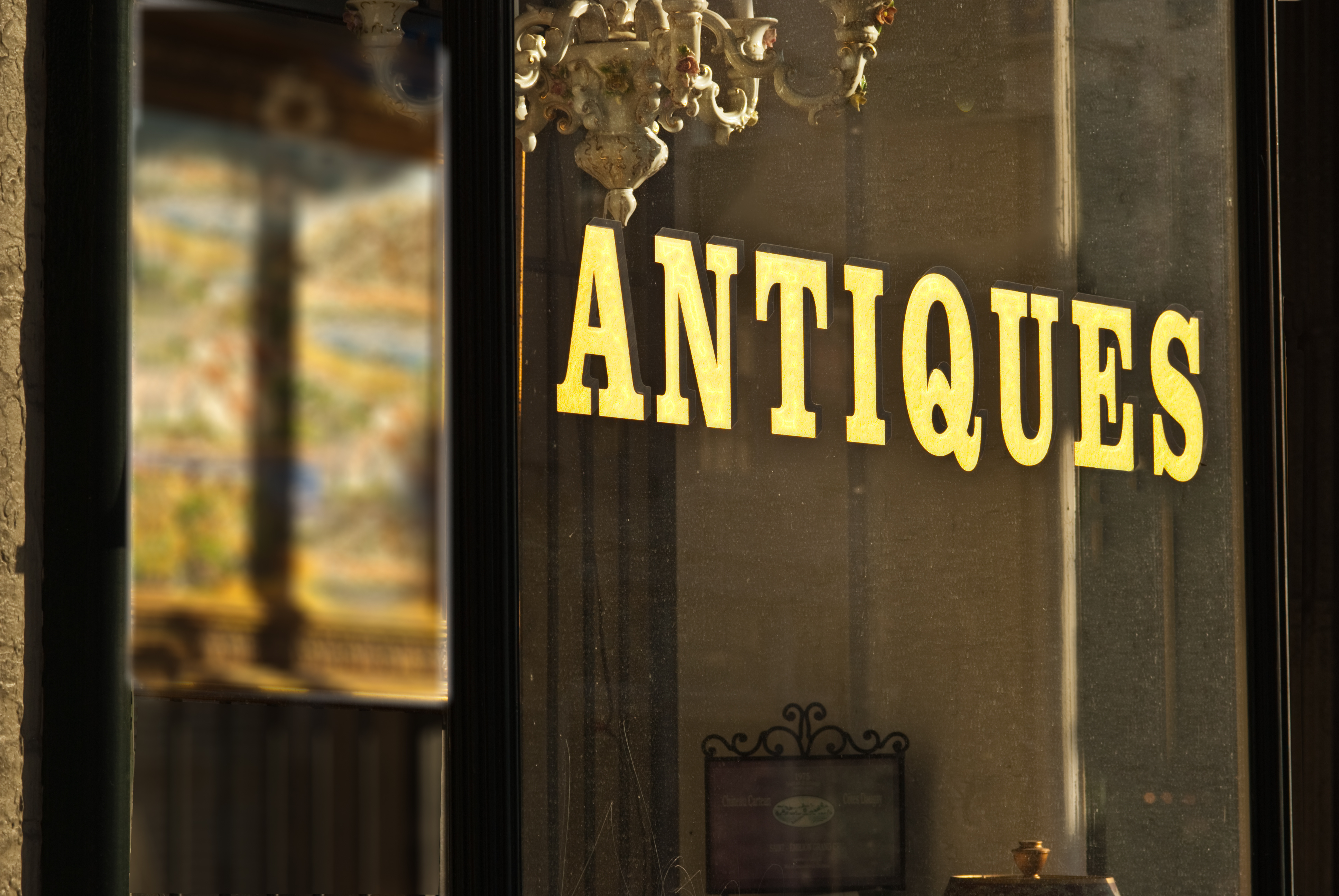 Antique store window sign wilth gold letters - Gotham Signs & Graphics